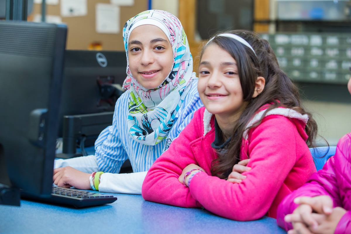 two girls smiling in class