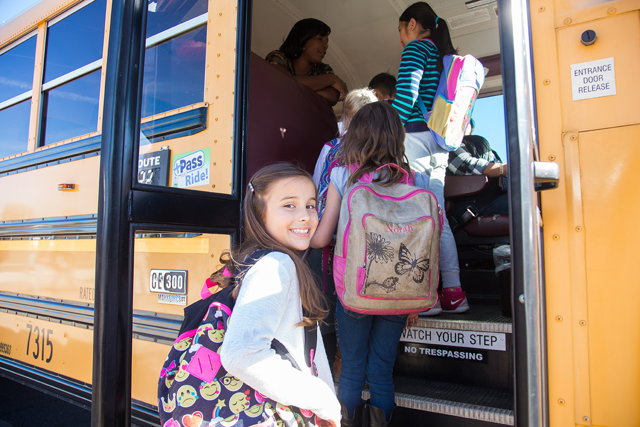 Students get on a school bus.